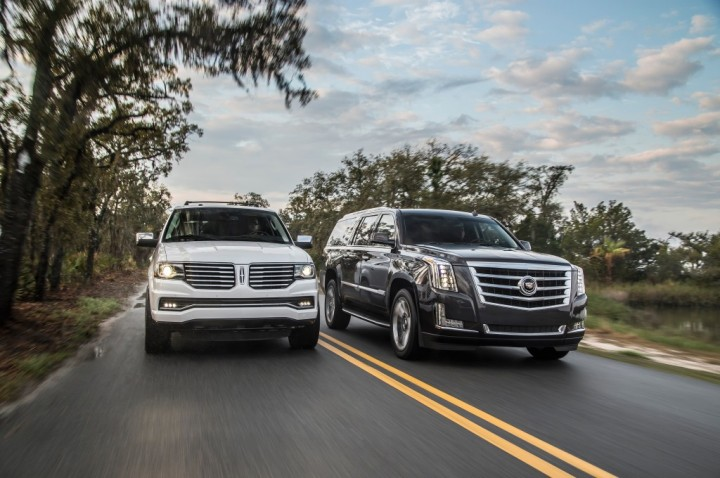 2015-lincoln-navigator-2015-cadillac-escalade-front-end-in-motion